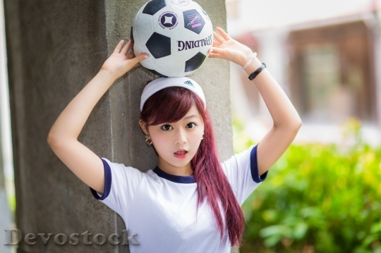 Devostock Girl HIGH SCHOOL PLACING SOCCER BALL HEAD