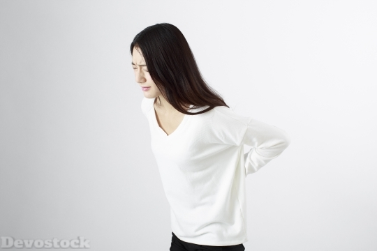 Devostock JAPANESE LADY BACK PAIN Girl