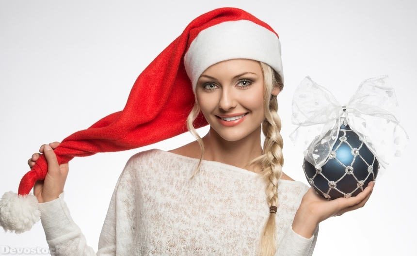 Devostock Beautitful Christmas Winter Hat Balls Braid hair Smile Gray Background Girl 4k