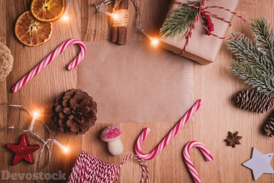 Devostock Christmas Gifts Frame Background Candy Cane Pine 4k