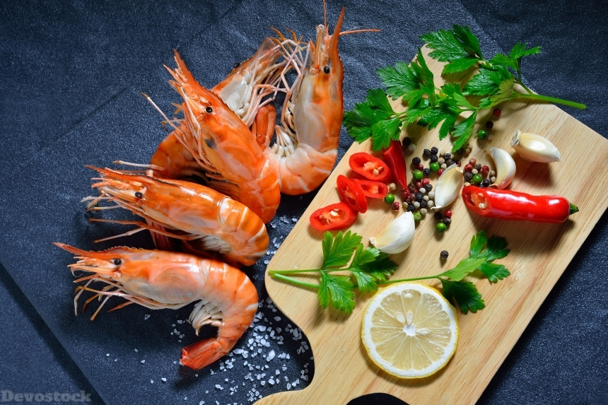 Devostock Cooked shrimps,prawns with seasonings on stone background