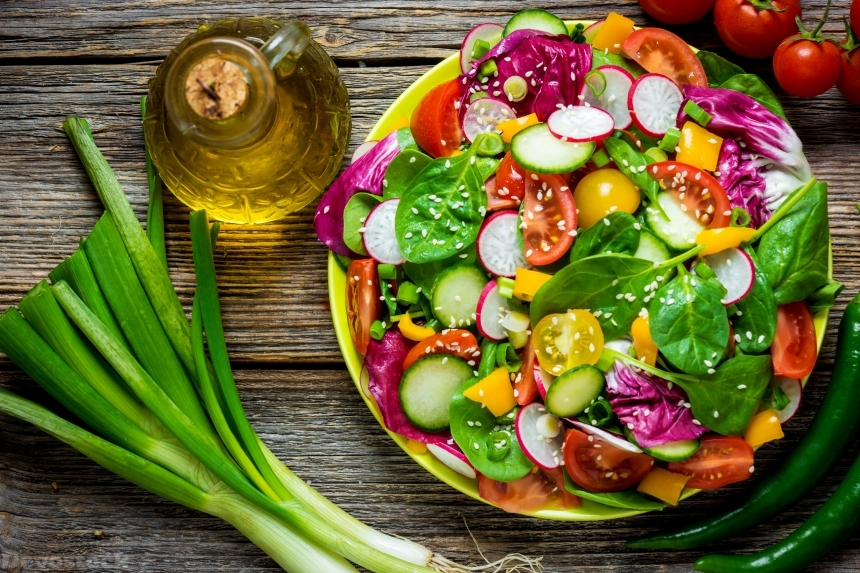 Devostock Fresh vegetable salad on wooden background