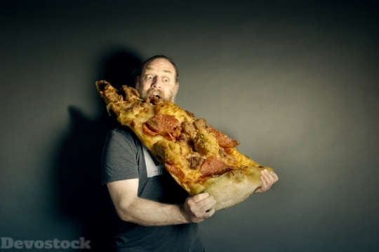 Devostock Funny Man Eating Very Huge Pizza Hungry 4K