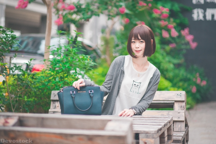 Devostock Outdoor Flowers Taiwanese Girl Sitting Table Bag 4k