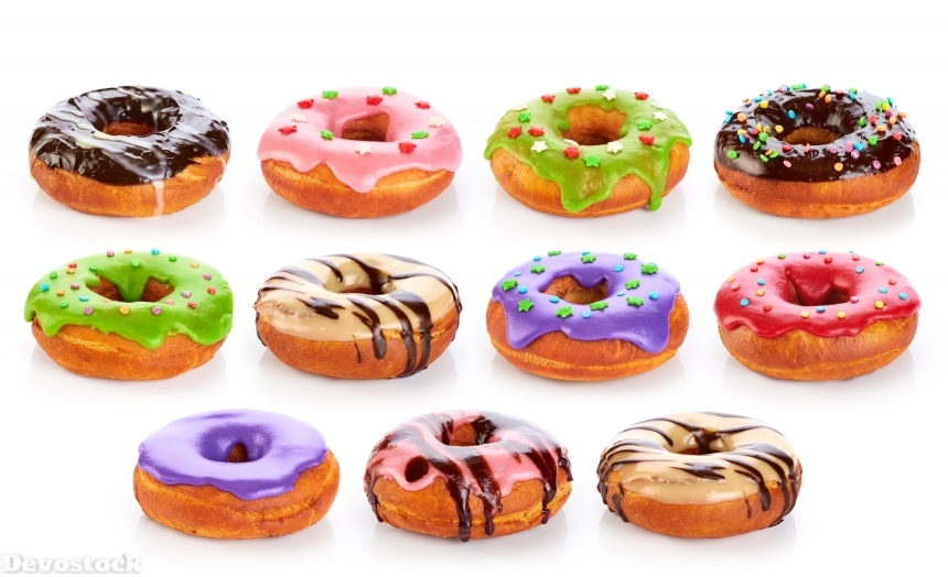 Donuts with colored glaze and chocolate, isolated on white backg
