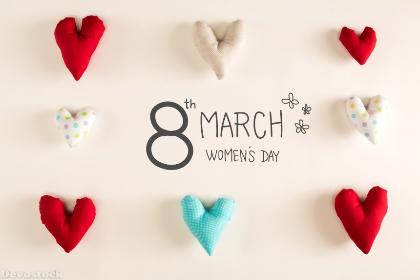 Women's Day message with blue heart cushions